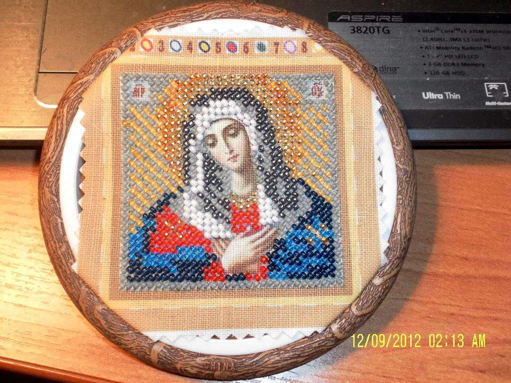 Икона  'Умиление Богородицы'. Оформленные