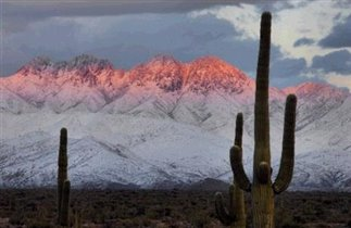 Snow on Superstition Mountains. Sunset.