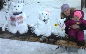Снежное семейство кошачьих