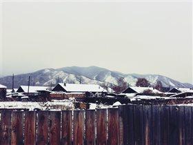 Тихо дремлят дома в объятиях зимы..