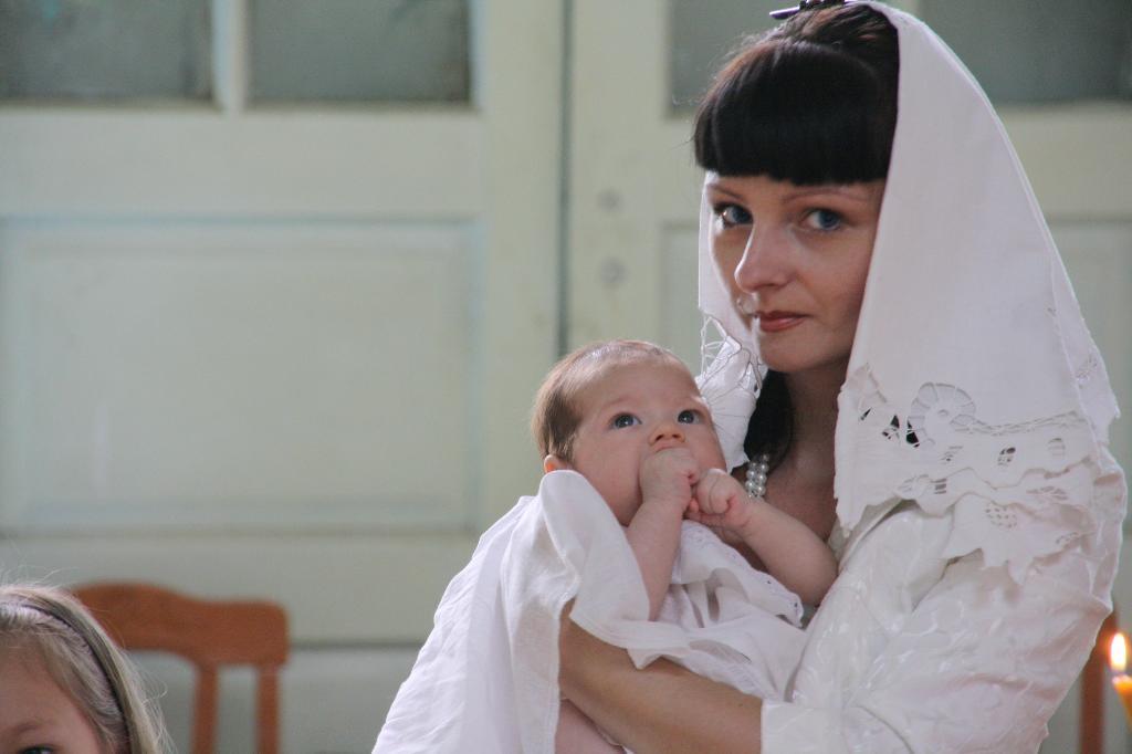на руках у кресной мамы. Мадонна с младенцем