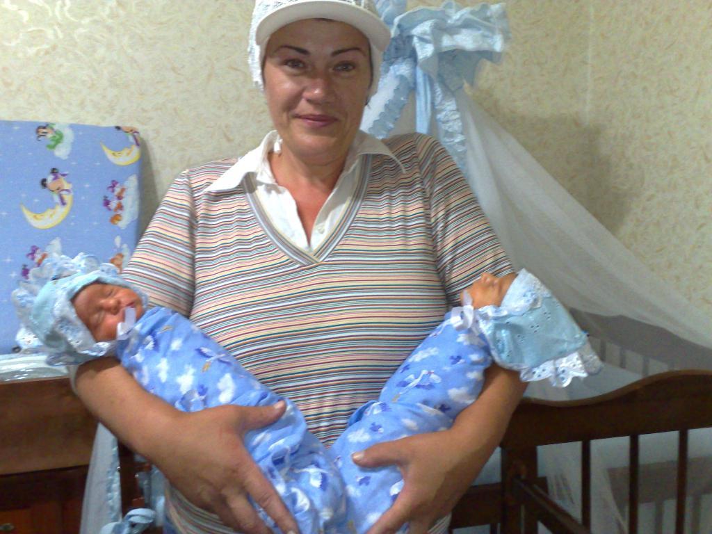 совсем не мадонна!))). Мадонна с младенцем