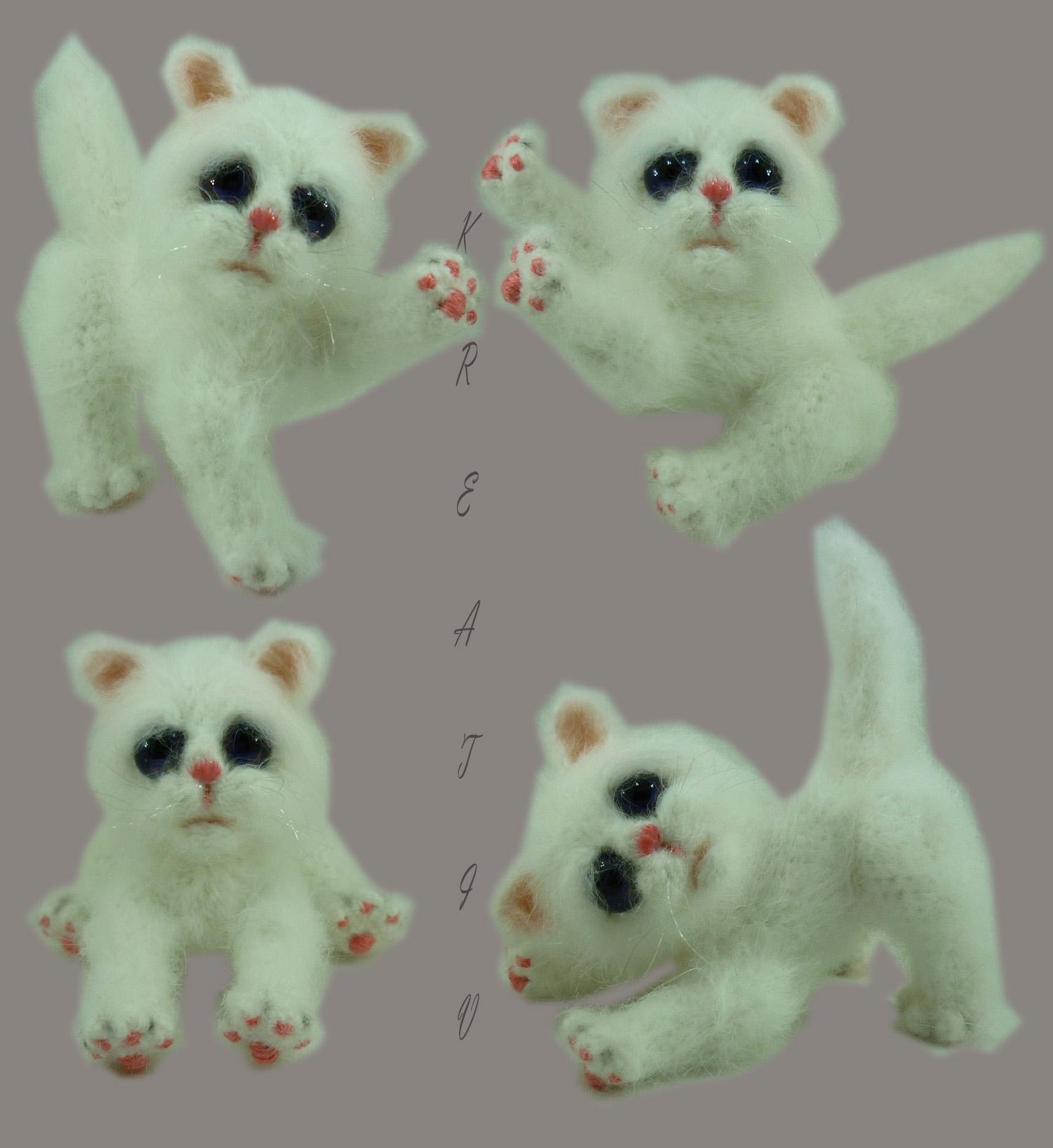 Белый котЭ.. Вязаные игрушки