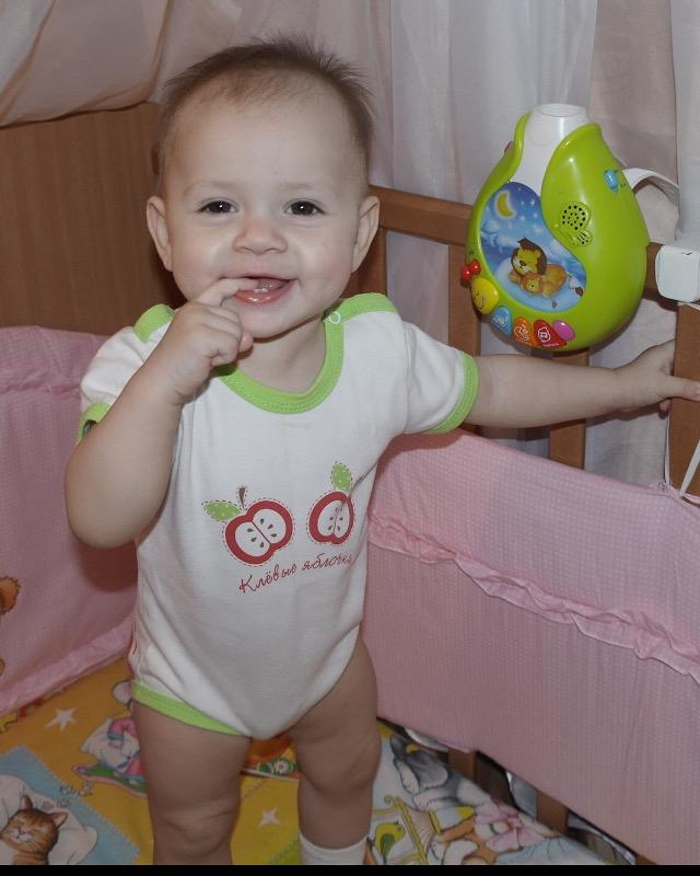 Улыбка дочурки и первые зубки. С улыбкой по жизни