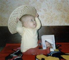 Ну как, мне идет эта шляпка?