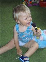 певец