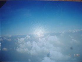 Зима за окном самолета