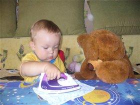 Алеша учит мишку гладить белье