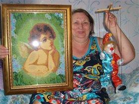 Марионетка и вышитый ангелок