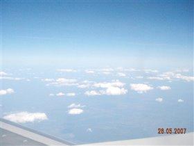 Над крылом самолета....