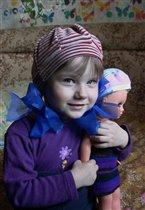 С любимой куклой
