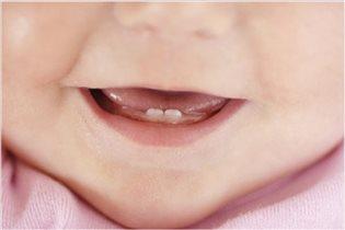 Первые зубки.