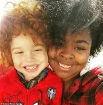 Рыжий ребенок чёрная мама